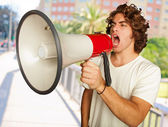 Portrait Of A Handsome Young Man Shouting With Megaphone — Stock Photo