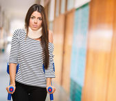Portrait Of A Young Woman With Crutches — Stock Photo
