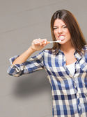 Angry Young Woman Brushing Her Teeth — Stock Photo