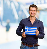 Young Man Holding Greece Flag — Stock Photo