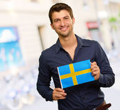 Young Happy Man Holding Sweden Flag — Stock Photo