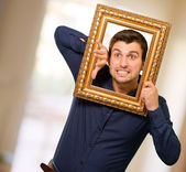 Young Man Holding Picture Frame — Stok fotoğraf