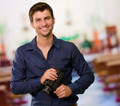 Portrait Of Young Man Holding Camera — Stock Photo