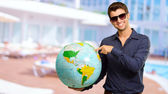 Young Man Wearing Goggle Showing Destination — Stock Photo