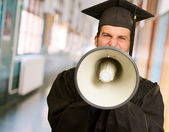 Graduate Man Shouting Into The Megaphone — Stock Photo