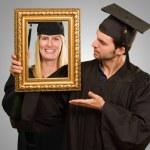 Graduate Man Holding Frame — Stock Photo #18780243