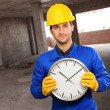 Stock Photo: Engineer Holding Wall Clock
