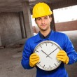 Engineer Holding Wall Clock — Stock Photo