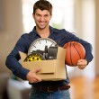 Happy Young Man Holding Cardboxes Gesturing — Foto de Stock