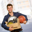 Happy Young Man Holding Cardboxes Gesturing — ストック写真