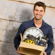 Portrait Of Happy Man Holding Cardboard Box — Stock Photo