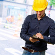 Portrait Of Architect Writing On Clipboard — Stock Photo