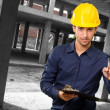 Architect Holding Clipboard And Pen - Stock Photo