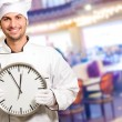 Male Chef Holding Wall Clock — Stock Photo #18784501