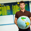 Young Man Holding Globe — Stock Photo #18786375