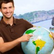 Young MShowing Destination On Globe — Stock Photo #18786529