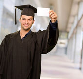 Graduate Man Showing Placard — Stock Photo
