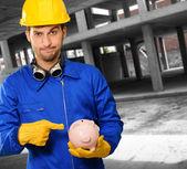 Engineer Holding Piggy Bank — Stock Photo