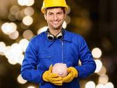 Happy Engineer Holding Piggy Bank — Stock Photo