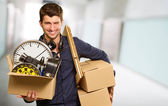 Young Man Holding Cardboxes Gesturing — Stock Photo