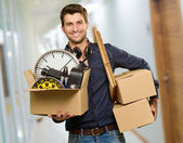 Happy Young Man Holding Cardboxes — Stock Photo