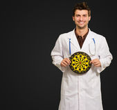 Happy Young Doctor Holding Bulls Eye — Stock Photo
