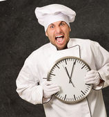 Male Chef Holding Wall Clock — Stockfoto