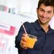 Young Man Holding Glass Of Orange Juice — Stock Photo