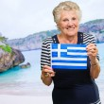 Happy Senior Woman Holding Greece Flag — Stock Photo #18796137