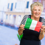 Happy Senior Woman Holding Greece Flag — Stock Photo #18796165