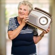 Stock Photo: Happy Mature WomHolding Radio