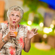 Woman Sipping Juice Through Straw — Stock Photo