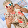 Afraid Senior Woman Watching 3d Movie - Stockfoto