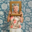 Senior Woman Holding Picture Frame  — Stock Photo