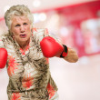 Angry Mature Woman Wearing Boxing Gloves — Stockfoto