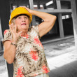 Senior Woman Wearing Hard Hat - Stock Photo