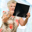 Stock Photo: Senior WomHolding X Ray Report