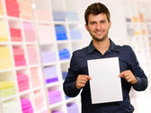 Young Man Holding Blank Paper — Stock Photo