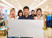 Man Holding Blank Placard And Woman Screaming From Behind — Stock Photo