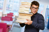 Young Man Holding Pile Of Books — Stock Photo