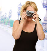Mature Woman Holding Camera — Stock Photo