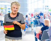 Unhappy Senior Woman Holding Germany Flag — Stockfoto