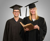Portrait of two graduate students — Stock Photo
