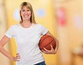Happy Woman Holding a basket ball — Stock Photo