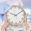 Portrait Of A Chef Holding Wallclock - Stock Photo