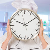 Portrait Of A Chef Holding Wallclock — Stock Photo