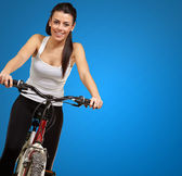 Portrait of a young girl sitting in bicycle — Stock Photo