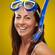 Stock Photo: Portrait of happy middle aged womwearing snorkel and goggle