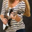 Young Woman Playing Guitar - Stock Photo