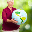 Royalty-Free Stock Photo: Senior Woman Holding Globe